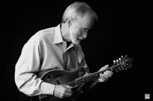 Roland White playing mandolin, photo by Mickey Dobo